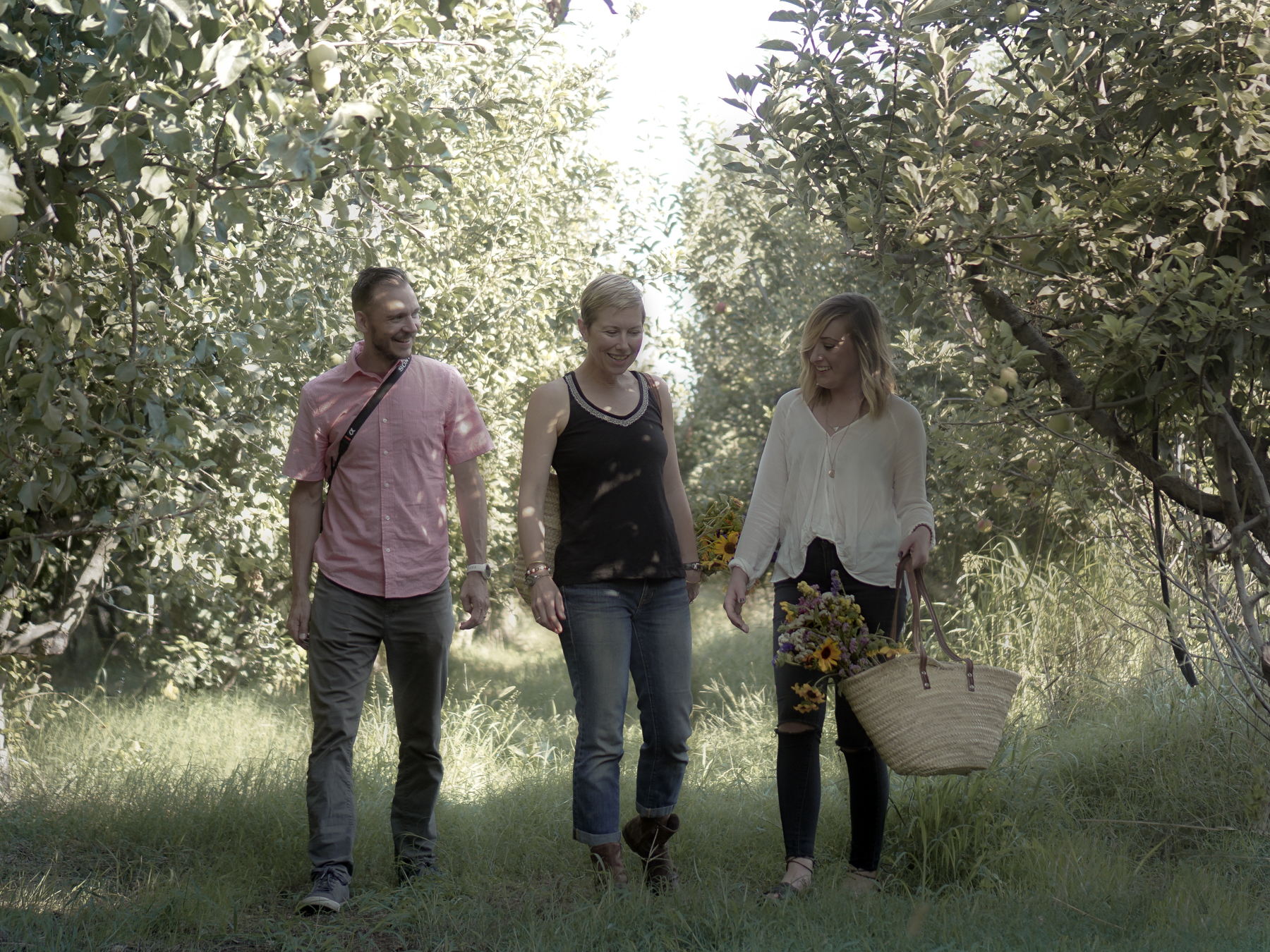 The Green Leaf Kitchen Team at full belly farm in the apple orchard
